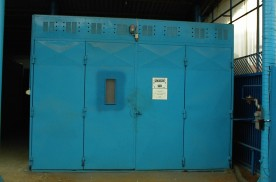 Metal particle spray booth